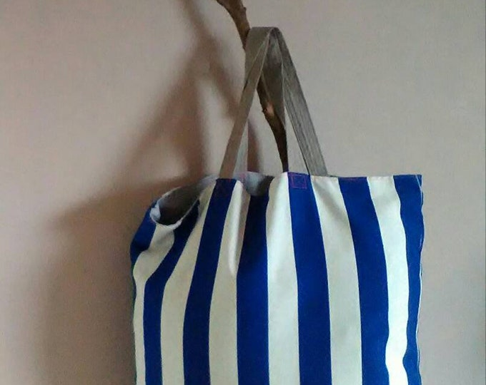 Extra large, lined, striped, double faced tote bag.