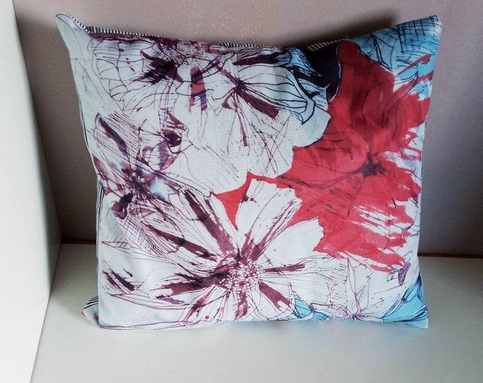 A decorative envelope cushion