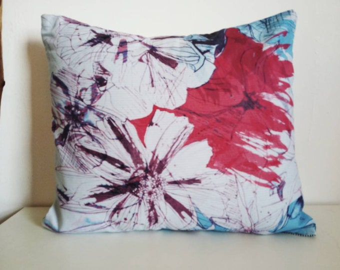 Beautiful blue and burgundi tones , floral cushion