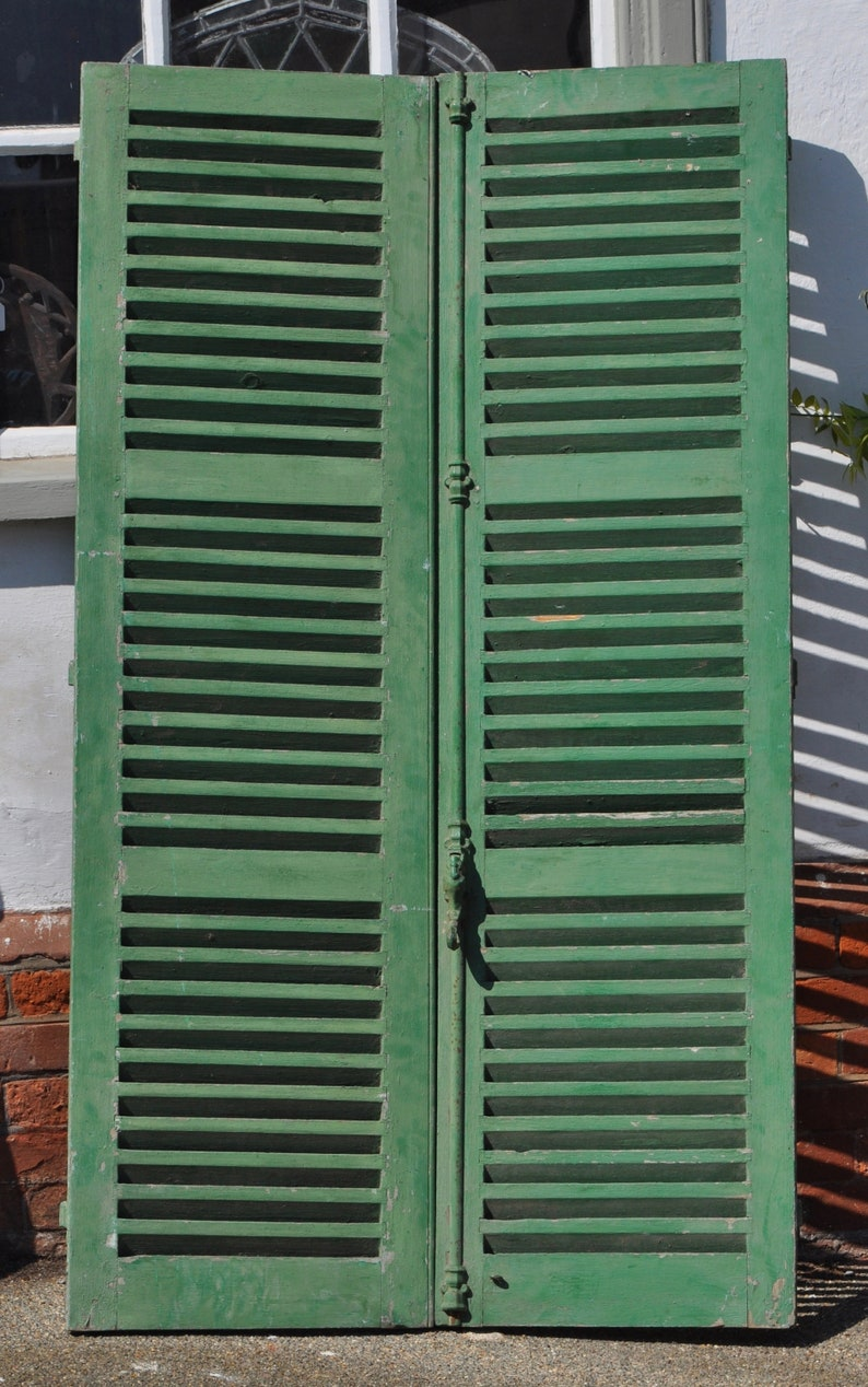 Antique Pair Of Window Shutters Still Retaining The Original Green Chalky Paint