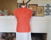 Orange blouse / shirt from the 1960s. Size EU 38-42 / UK 10-14 / US 6-10