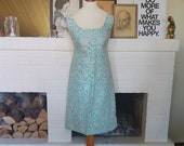 Cocktail / party dress from the 1960s. Size EU 34 / UK 6 / US 2. Chest 85 cm / 33,5 inches