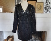 Awesome jacket / coat / short dress with sequins from the 1980s. Size EU 40-42 / UK 14-16 / US 10-12. Chest 104 cm / 40,9 inches