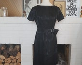 Black Cocktail dress from the 1950s /1960s.  Size EU 36 / UK 8 / US 4. Waist 74 cm / 29 inches