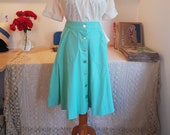 A-line skirt from the 1970s. Size EU 32 / UK 6 / US 2. Waist 64 cm / 25.2 inches