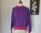 Knitwear from the 1980s. Size EU 38-40 / UK 12-14 / US 8-10. Chest 106 cm / 41.7 inches