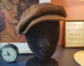 Leather hat // Leather cap from the late 1960s or the 1970s. Width around head 54,5 cm / 21,5 inches.