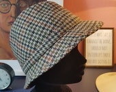 Check hat from the 1960/1970s. This hat is made in England. size 59.