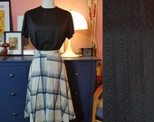 Black cotton blouse from the 1960s. Size EU 46 / UK 20 / US 16.  Chest 110 cm / 43,3 inches