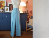 Dove blue palazzo pants from the 1970s. New old stock. Deadstock. Size EU 36 / UK 10 / US 6. Waist 72 cm / 28,3 inches