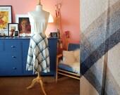 Tartan skirt from the 1970s. Pleated tartan skirt. Size EU 38 / UK 12 / US 8.  Waist 76 cm / 29,9 inches