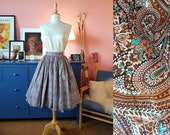 Full circle skirt from the 1950s/1960s. Size EU 36 / UK 10 / US 8.  Waist 72 cm / 28,3 inches
