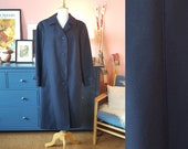 Marin blue coat from the 1960s. Wool coat. Rare larger size vintage.  Size EU 42-44 / UK 16-18 / US 12-14. Chest 104 cm / 40,9 inches.