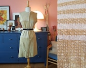 Day dress from the 1950s/1960s. Size EU 36 / UK 10 / US 6. Waist 74 cm / 29,1 inches.