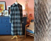 Lovely winter coat from the late 1950s or early 1960s. Size EU 40-42 / UK 14-16 / US 10-12.  Chest 100 cm / 39,4 inches.