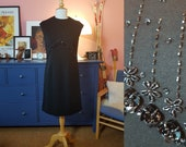 Cocktail dress from the 1960s. Little black dress. Size EU 34 / UK 8 / US 4. Hips 92 cm / 36,2 inches