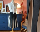 Beautiful skirt from the 1950s. Very petite. Size EU 30 / UK 4 / US 0.  Waist 48 cm / 18,9 inches