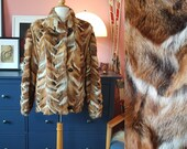 Fox fur coat from the 1980s. Magasin fox fur. Fox Fur. Size EU 40 / UK 14 / US 10. Chest 100 cm / 39,4 inches.