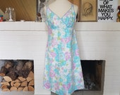 Beach / summer dress from the 1950s. Size EU 38 / UK 10-12 / US 6-8. Chest 94 cm / 37 inches