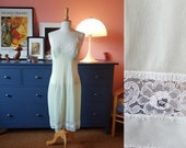 Slip dress / underdress / lingerie from the 1960s. Size EU 36 / UK 10 / US 6.  Waist 74 cm / 29,1 inches
