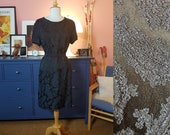 Cocktail dress from the 1960s. Size EU 40 / UK 14 / US 10. Waist 82 cm / 32,3 inches.