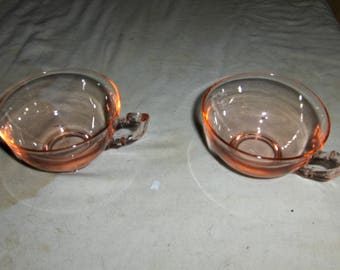 a pair of pink either snack cups or punch bowl cups