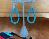 Turquoise beaded earrings in teardrop shaped loops