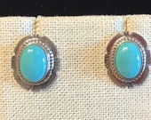 Southwest style sterling silver post earrings with turquoise stone