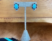 Vintage sterling silver post earring with large oval turquoise stone in silver bezel
