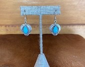 Southwest style Sterling Silver pendant earrings with a bezeled teardrop turquoise stone