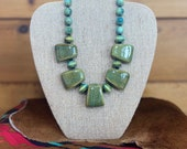 Green turquoise w black faceted beads