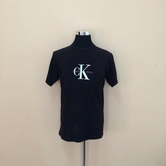 2fe9d50365a7 Vintage 90's Calvin Klein T-Shirt Big Logo // Calvin Klein | Etsy