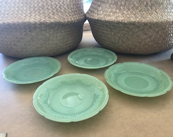This listing is for 4 Alice Jadite Fireking saucers