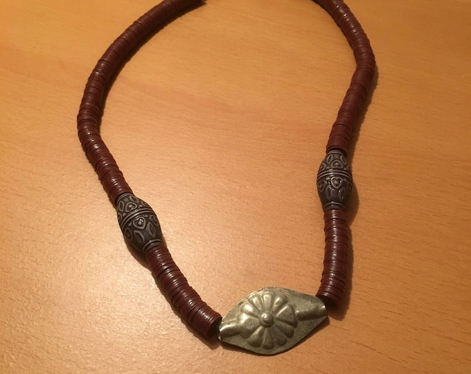 Handmade beaded necklace made of maroon african waist beads with 2 clay beads and 1 metal bead