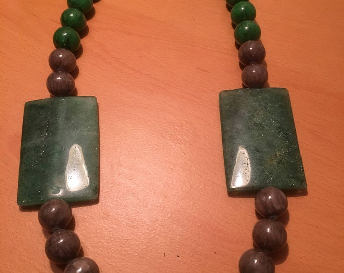 Handmade beaded necklace made of green and grey beads.