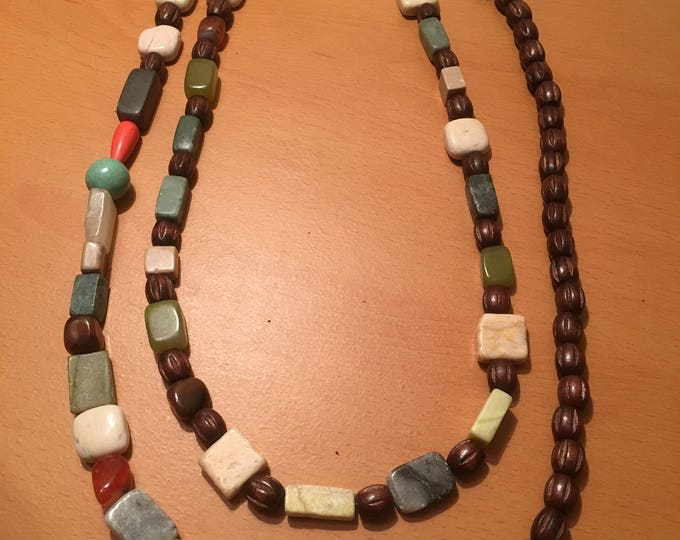 handmade beaded necklace, made of  assorted beads including wooden beads.