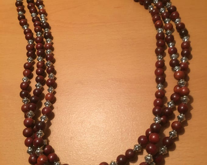 Handmade multi stranded beaded necklace made of maroon beads