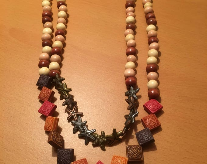 Handmade multicolored bead necklace made of regular beads, square shaped beads and starfish shaped beads
