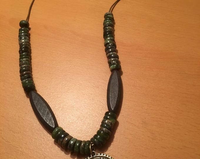 Handmade beaded necklace, A signature piece. Made of heishi beads, large brown wooden beads, pendant on an olive green leather chord