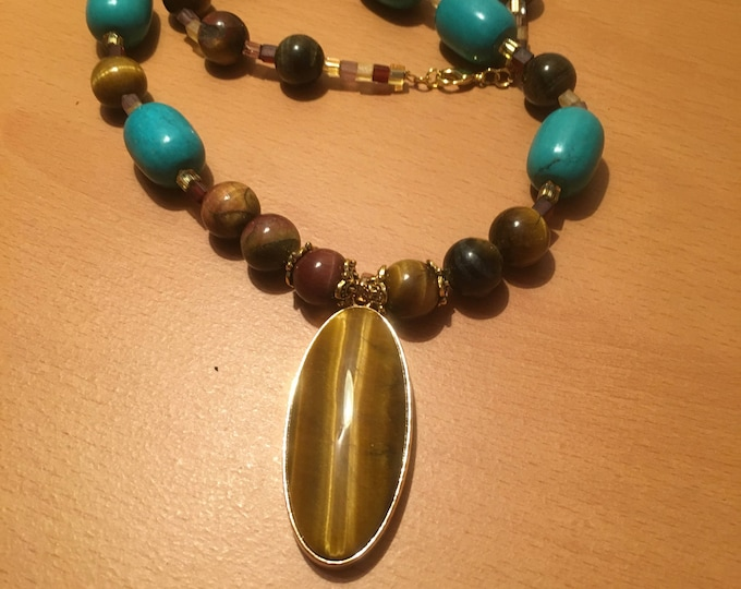 Handmade beaded necklace made of blue exotic and tiger's eye beads and pendant