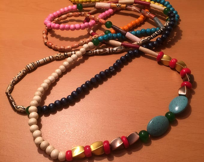Handmade triple wind beaded necklace made of multicolored and mixed beads.