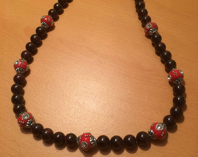 Handmade beaded necklace made of red exotic beads and maroon beads