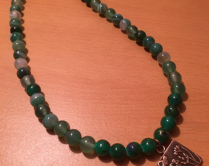 Handmade beaded necklace, A simple green beaded necklace with a copper colored pendant
