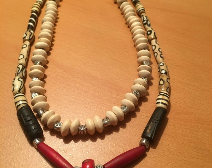 Handmade double stranded bead necklace made of red, black and beige wooden beads