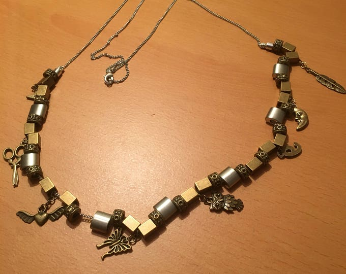 Handmade metal bead necklace with charms on a silver colored chain
