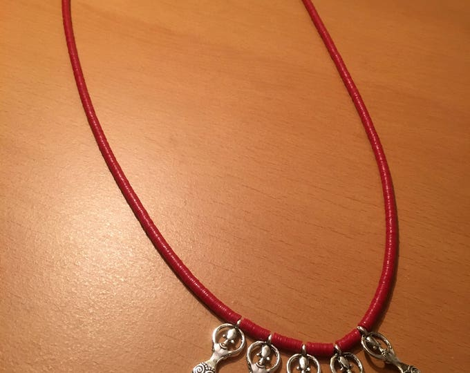 Handmade beaded necklace, A signature piece! A red african waist bead necklace with multiple silver colored pendants
