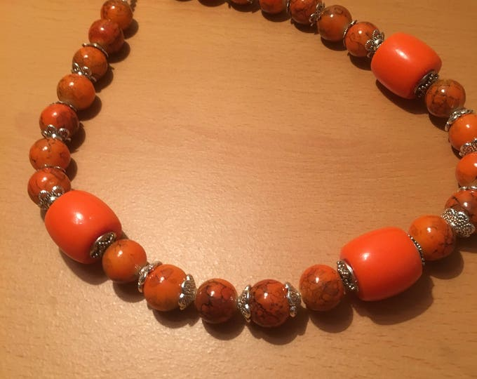 Handmade beaded necklace, An orange bonanza! made of orange colored and exotic beads