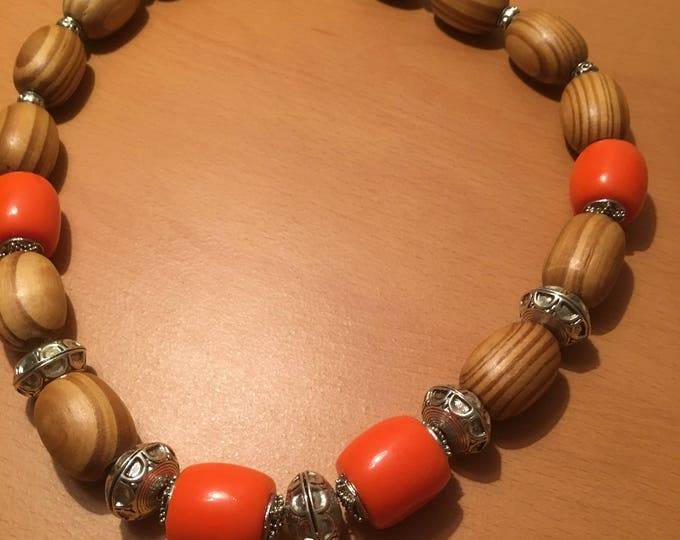 Handmade beaded necklace made of wooden beads, large orange colored and silver beads