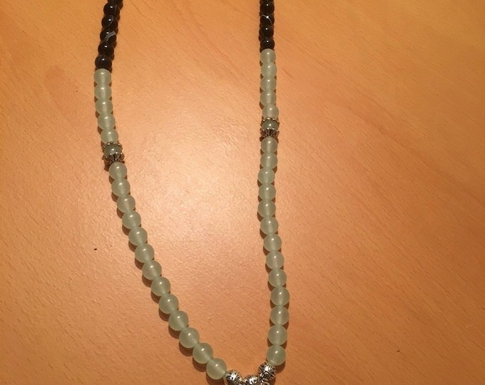 Handmade beaded necklace, A double pendant necklace with light green and black beads.