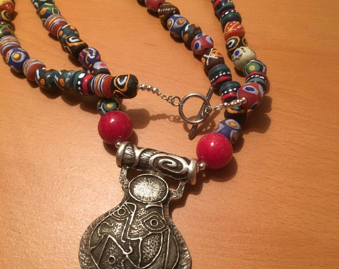 Handmade beaded necklace made of silver colored pendant and african multi colored beads